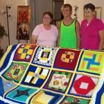 Iris, Ryne, Lynda with quilt