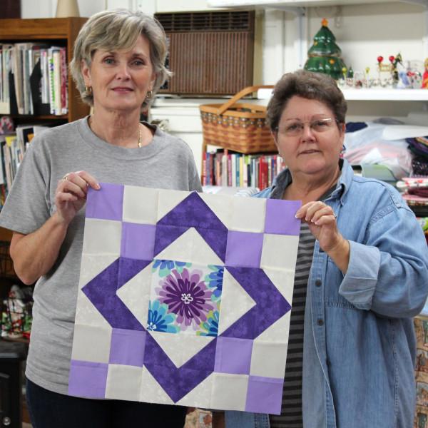 Linda Radford and Iris Tye Melvin with Pink Lemonade Block in Purple