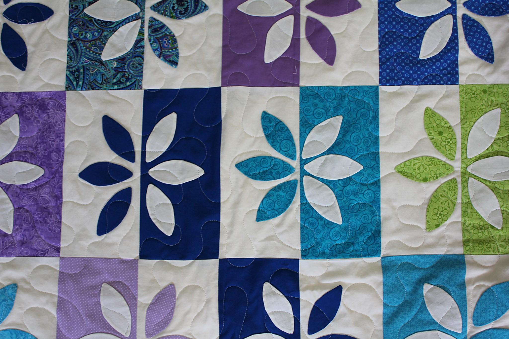 Appliqué Multicolor Petals Quilt
