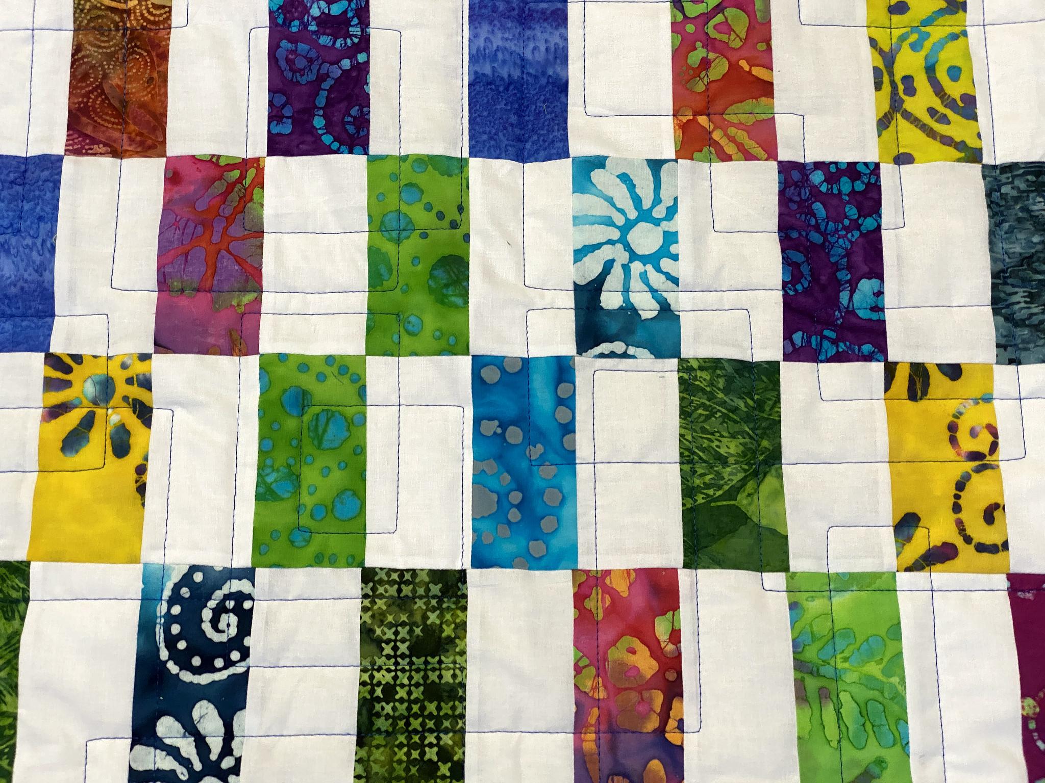 Patti's Batik Strip Patch Quilt